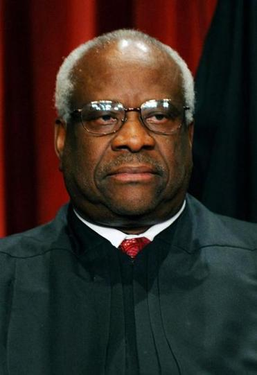 US Supreme Court Associate Justice Clarence Thomas participates in the courts official photo session on October 8, 2010 at the Supreme Court in Washington, DC. AFP PHOTO / TIM SLOAN (Photo credit should read TIM SLOAN/AFP/Getty Images) NYTCREDIT: Tim Sloan/Agence France-Presse -- Getty Images Library Tag 06282011 Business